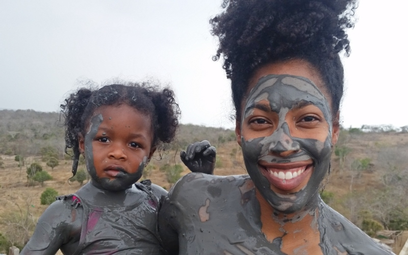 mom and daughter covered in mud