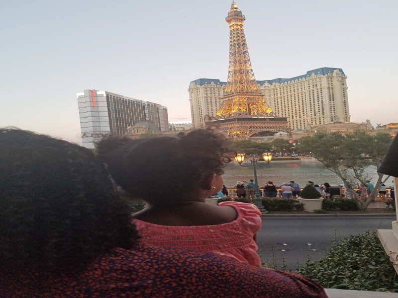 mom and daughter looking at the Eiffel Tower in Las Vegas