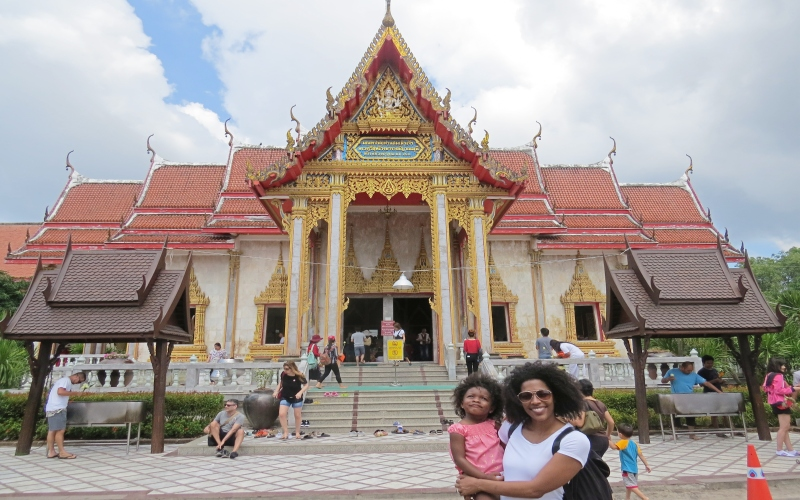 mom and daughter stading in front of a temple in Thailand