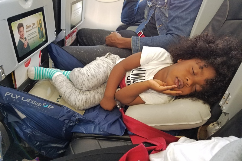 little girl sleeping on the plane