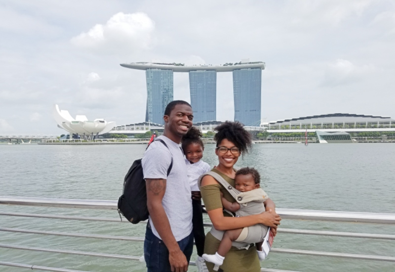 Family in Merlion Park with Marina Bay Sands in the background