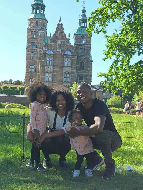 family standing in front of castle