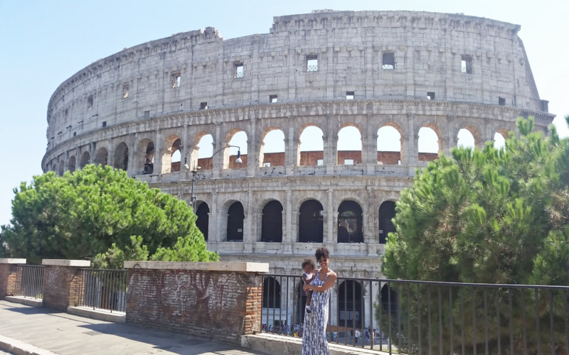mom and daughter standing in front of the colosseum