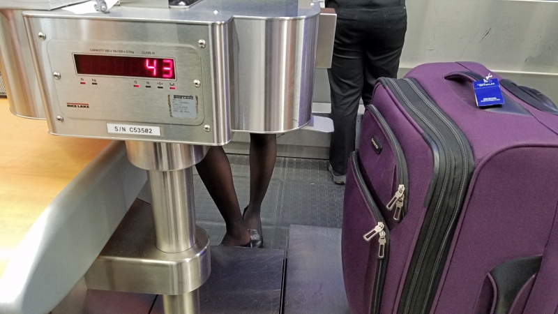 suitcase being weighed at the airport