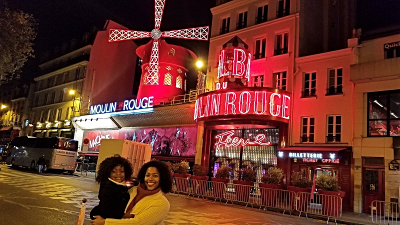 Mom and daughter posing in front of the Moulin Rouge