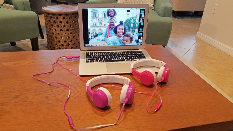 two headphones plugged into a computer