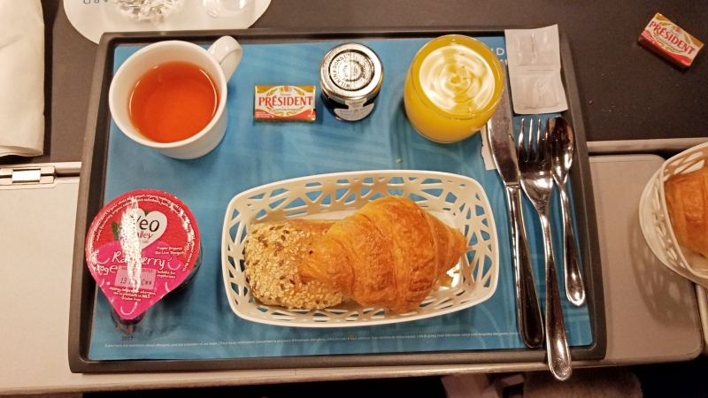 food on a tray on a train