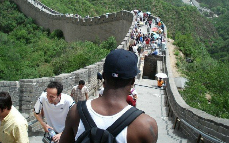 black man standing on the great wall of china