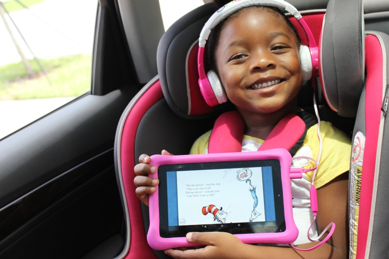 toddler girl listening to an ebook in the car