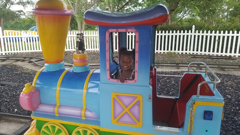 little girl on a kiddie train ride