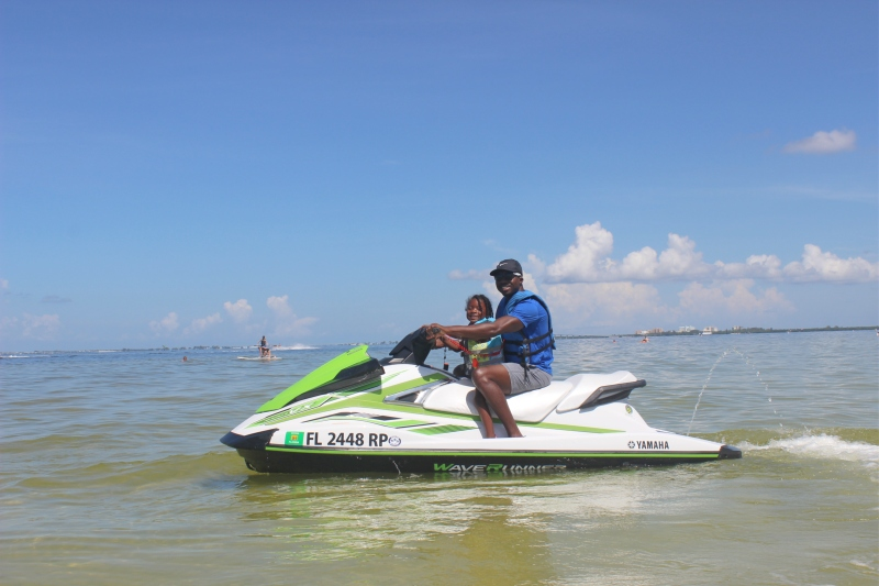 toddler jet skiing with dad