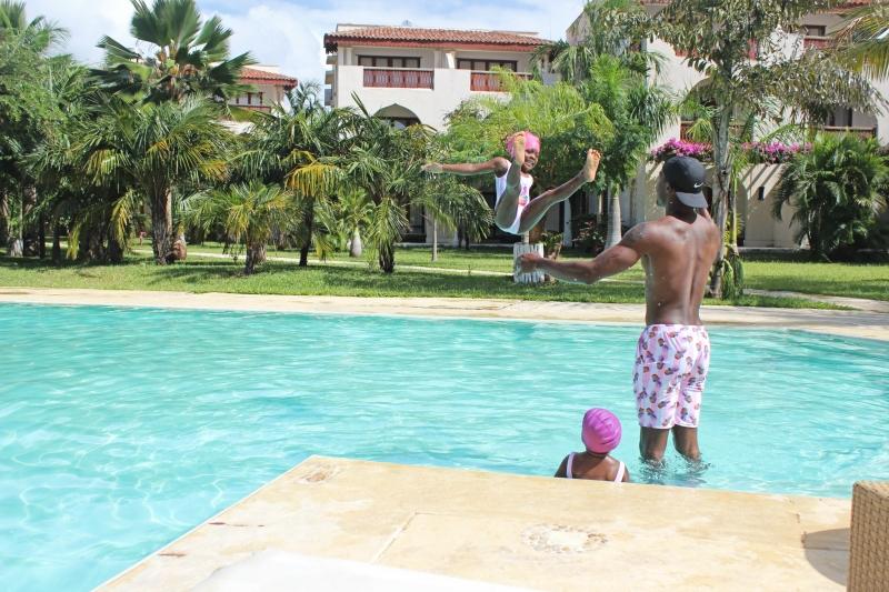 African Safari with Kids in Kenya dad throwing daughter in pool
