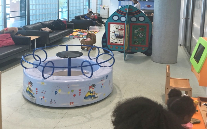 kids playing in play area at airport