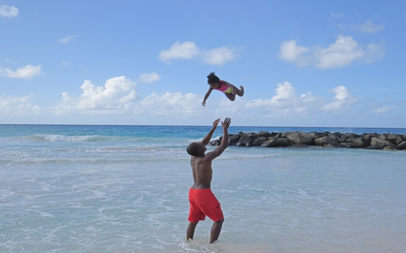 dad throwing daughter in the air