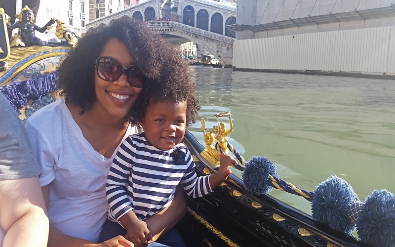mom and daughter on gondola in venice