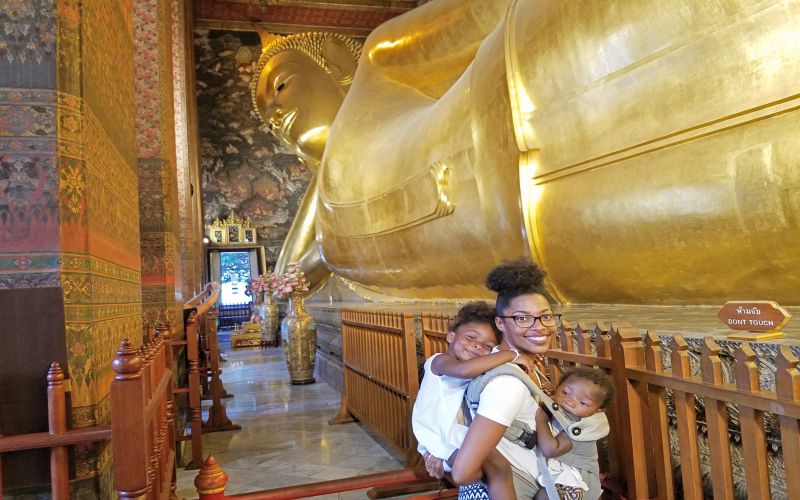 mom and daughters in front of Reclining Buddha