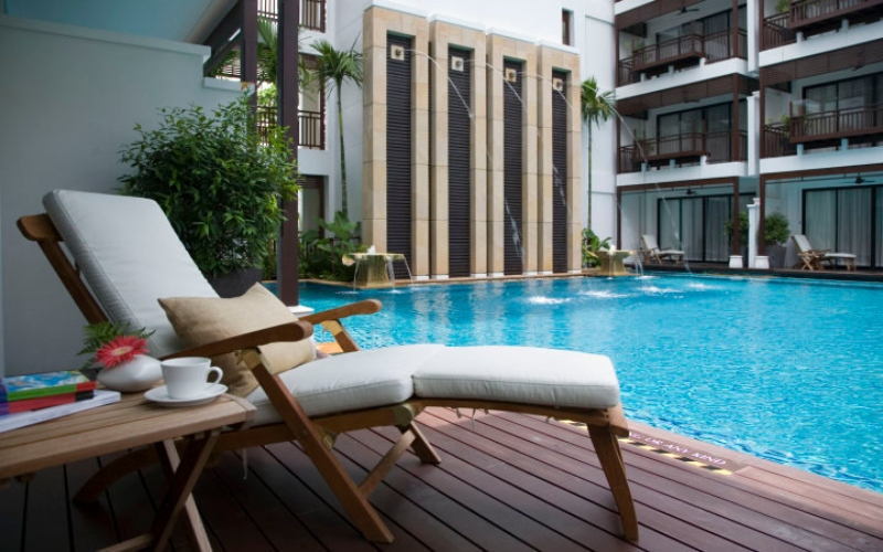 hotel pool with lounge chair