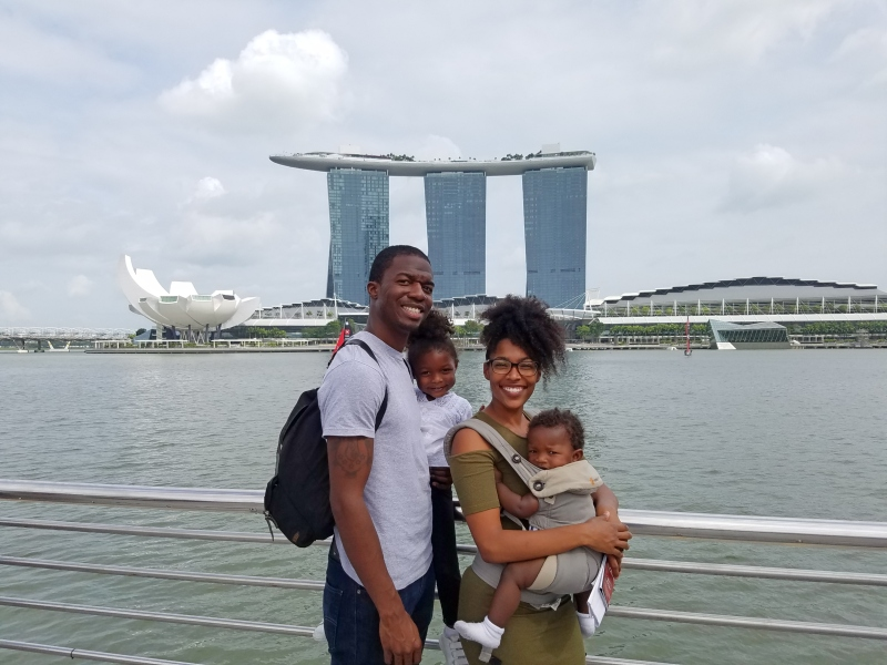 Black family standing in front of Marina Bay Sands in Singapore