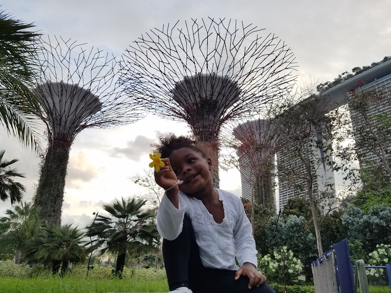Young black girl playing at Gardens By the Bay Supertrees