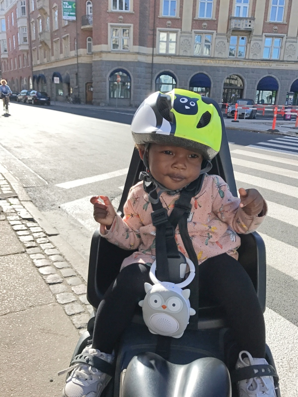 toddler sitting on bike seat