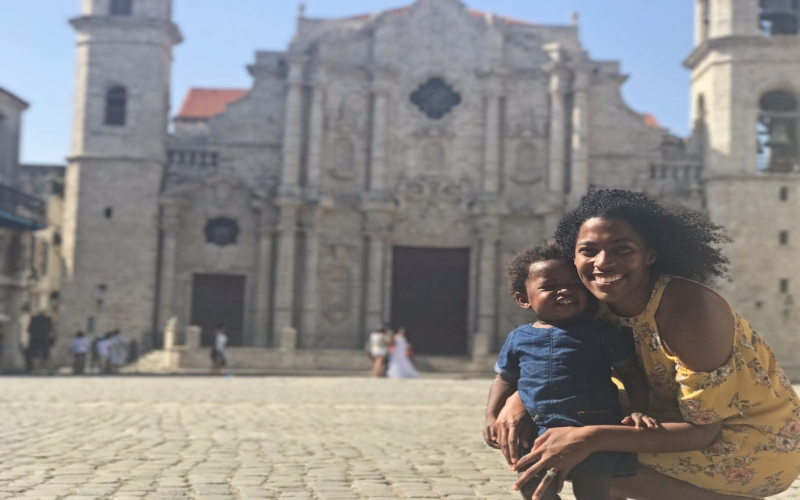 mom and daughter in front of a church in Havana
