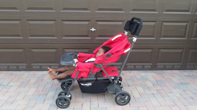 little girl laying down in a stroller