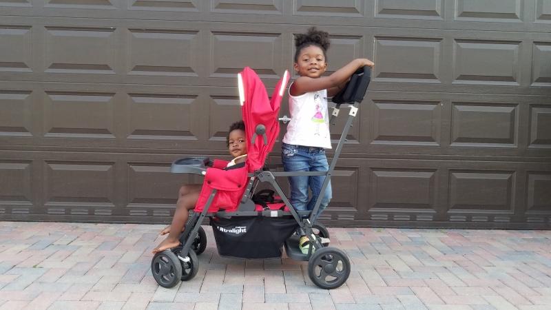 2 kids in a stroller