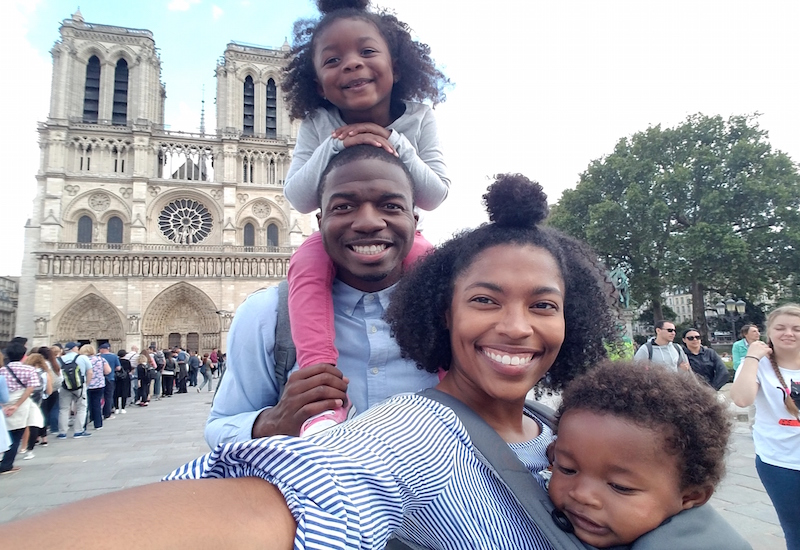 Family standing in front of the Notre Dame in Paris