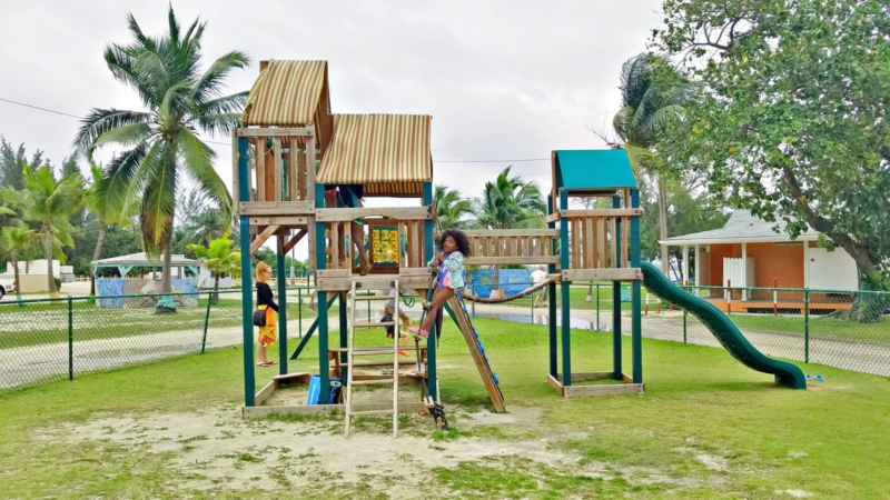 girl playing on playground in Grand Cayman