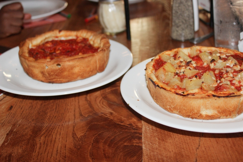 two personal pizzas on a table