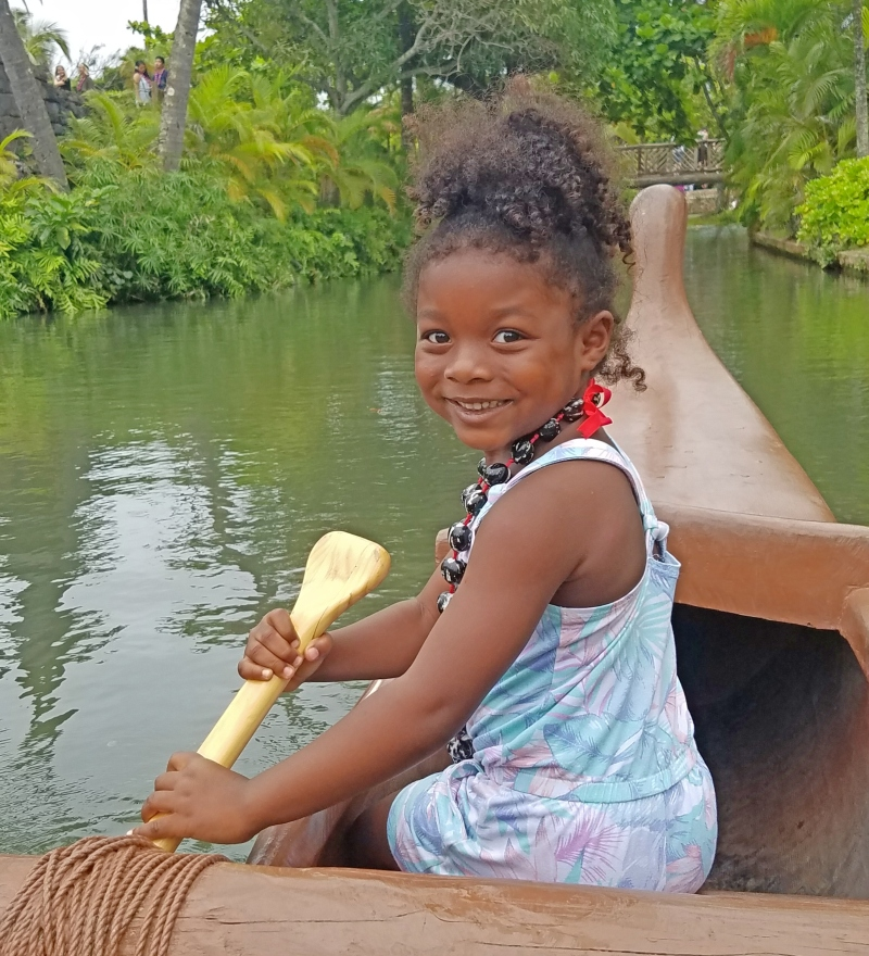 Little girl on a canoe