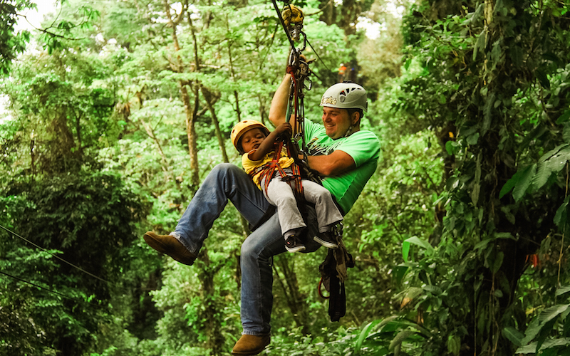 little girl and guide zip lining