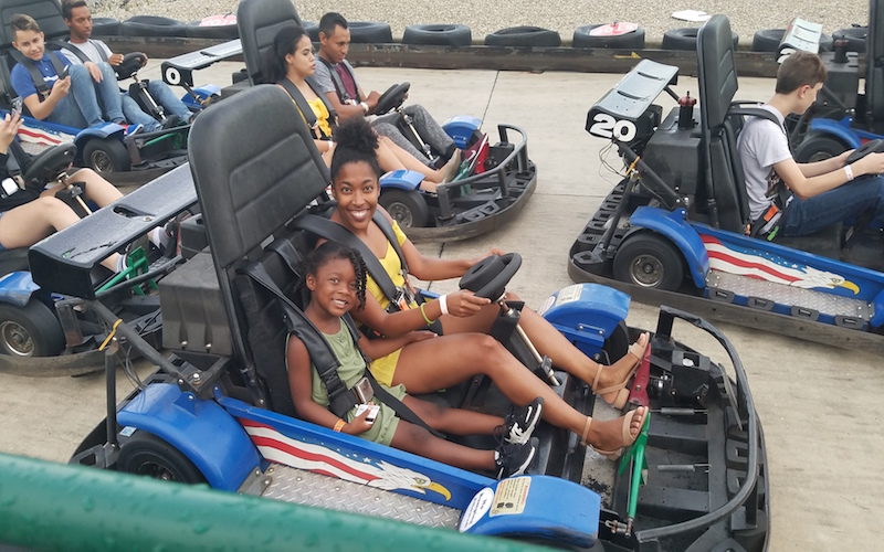 mom and daughter go-karting