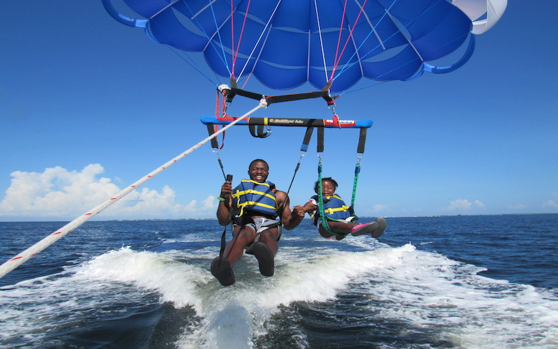 father and daughter parasailing