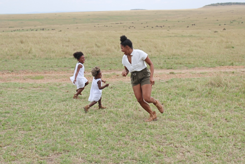 mom running in field with daughters