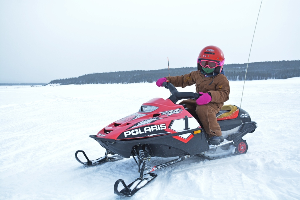 Family outdoor winter adventures snowmobiling