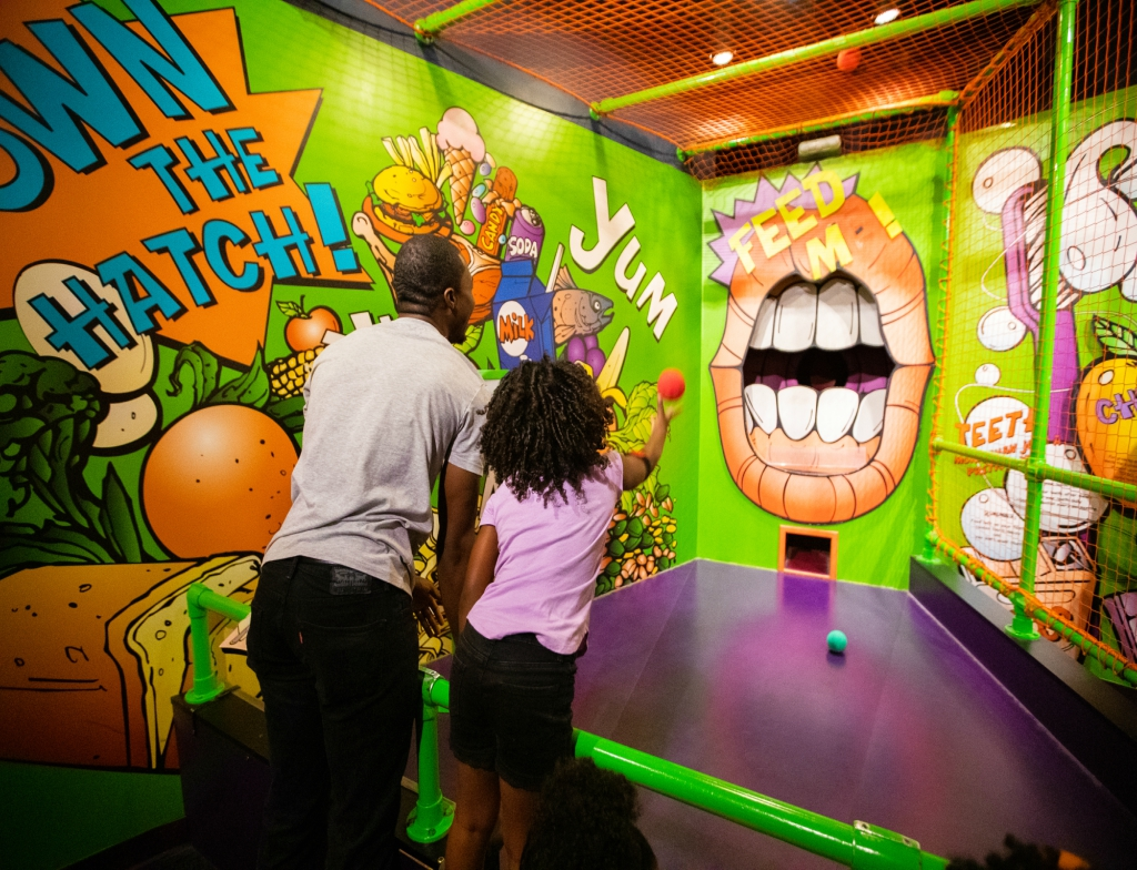 black father and daughter playing at Adventure Science Center in Nashville