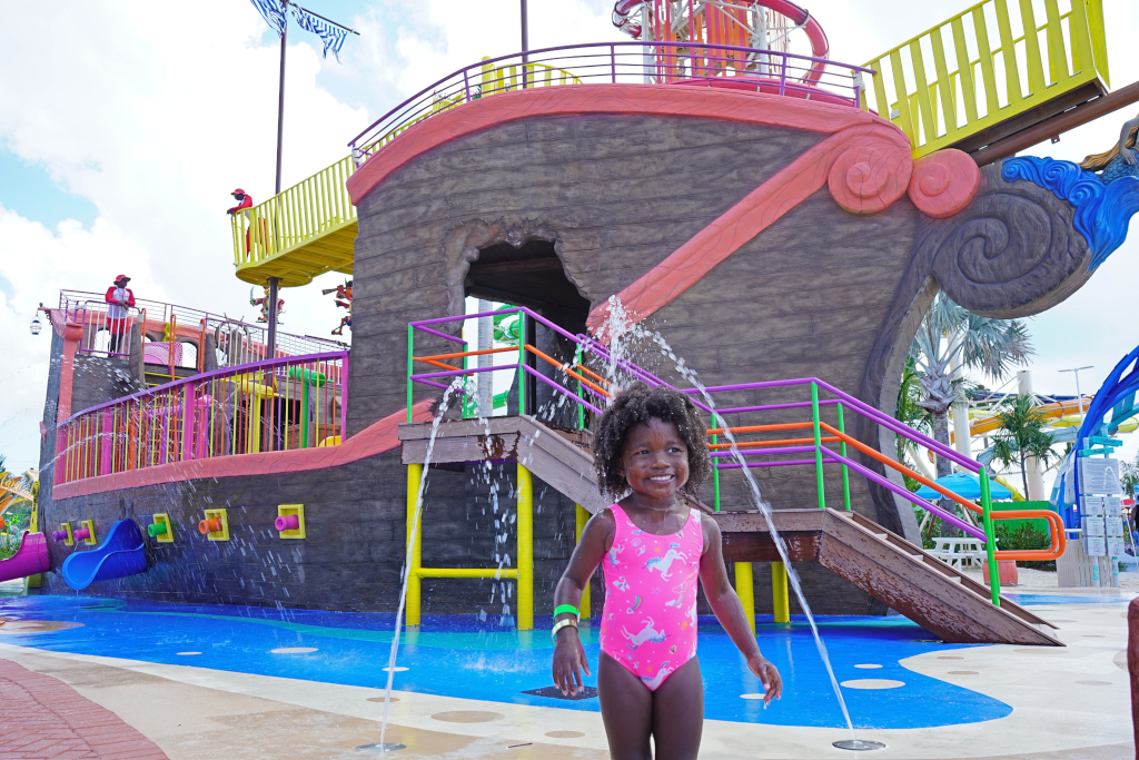 young girl in front of pirate ship water park
