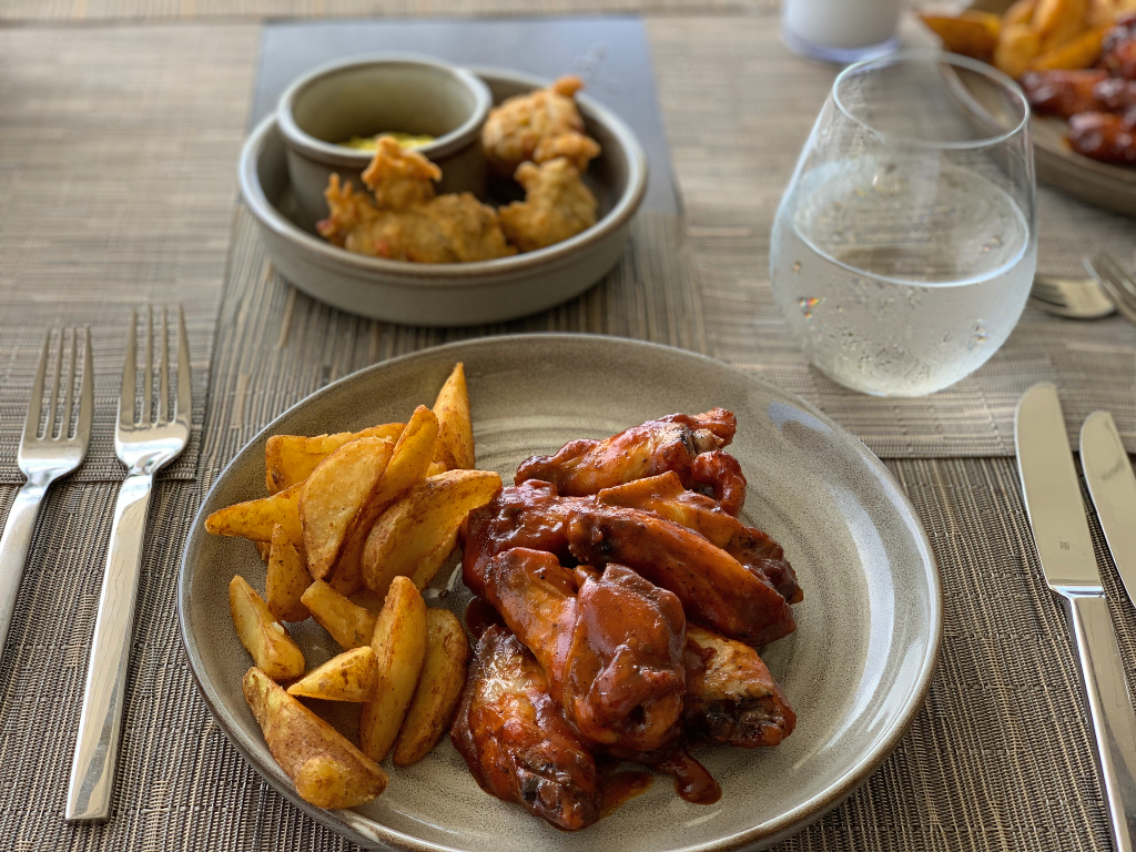 plate with bbq wings and fries
