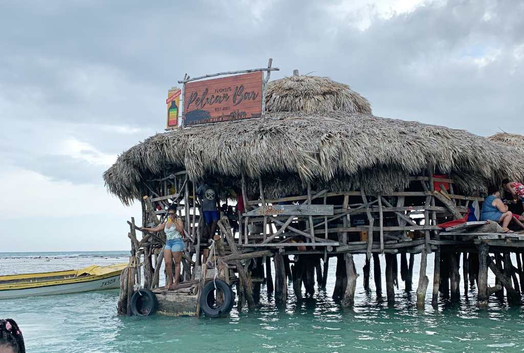 wooden hut bar in the middle of the ocean