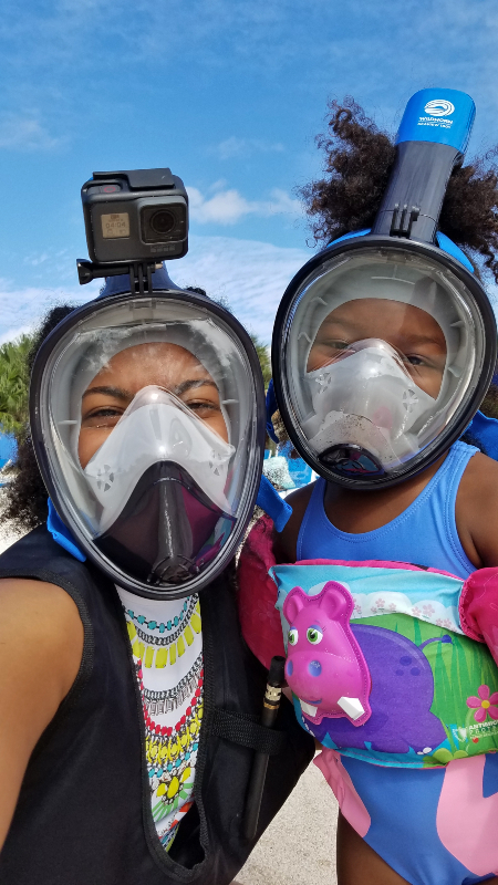 mom and daughter wearing snorkel masks