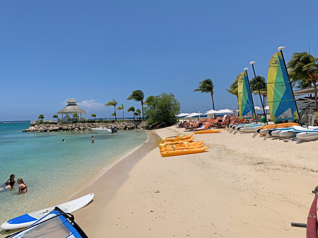 beach in Jamaica with kayaks and boats