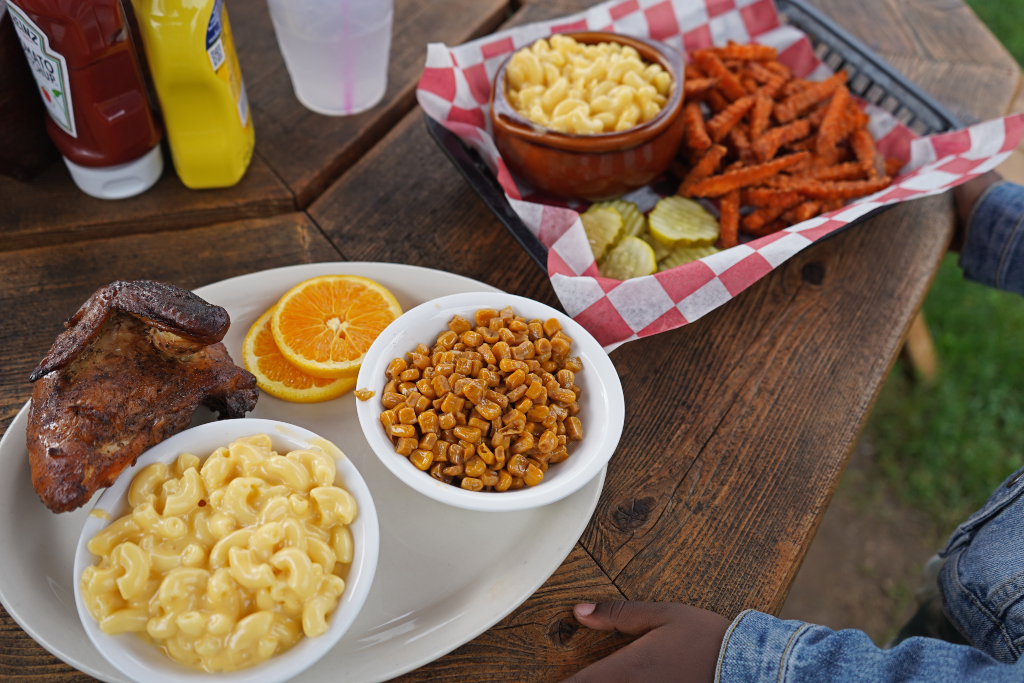 Lunch at Caseys' BBQ and smoke house in door county with a chicken smoked chicken breast, mac and cheese, sweet potato fries and corn.