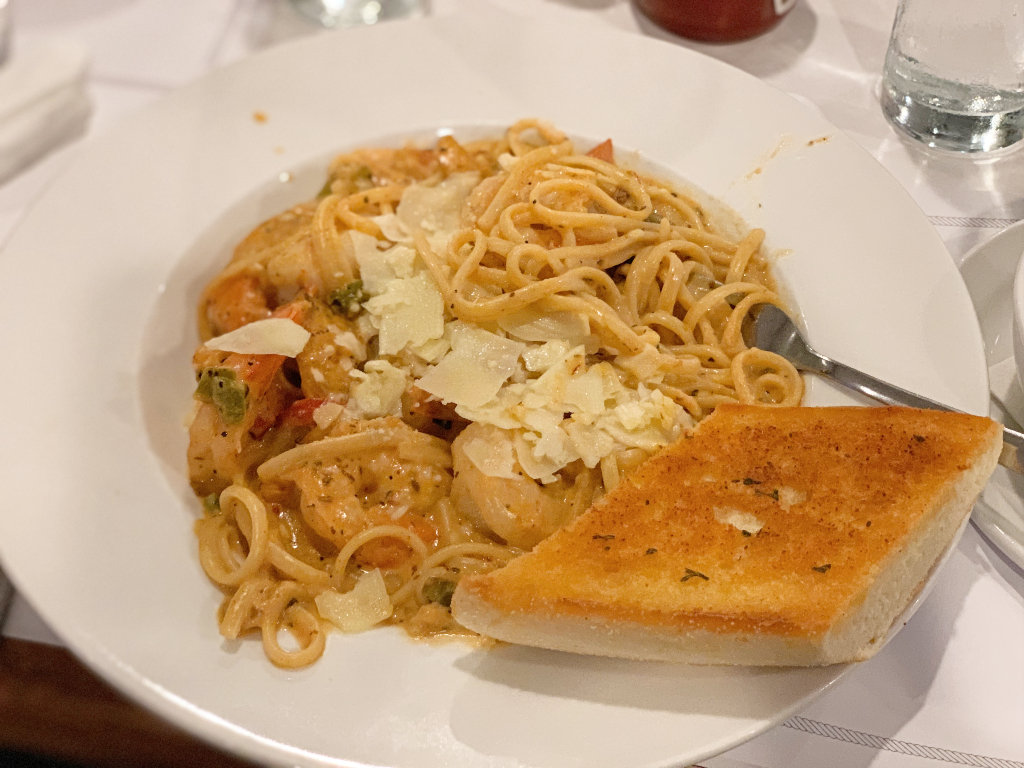 Shrimp fettucine Alfredo with a piece of garlic bread from the boathouse restaurant in door county, WI.