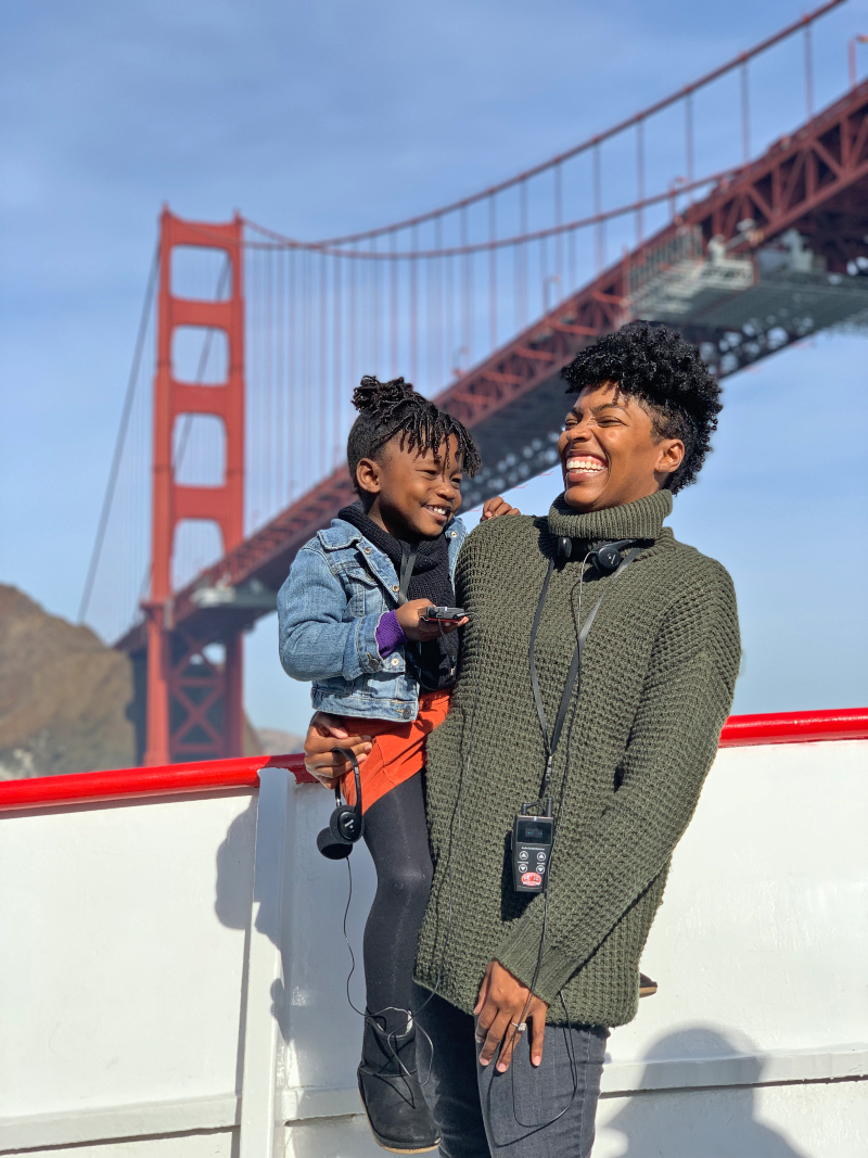 california road trip with kids mother and daughter on a boat under the golden gate bridge