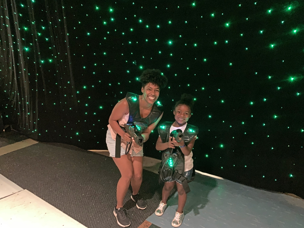 Mom and daughter dressed in laser tag vest to play on Navigator of the Seas cruise ship