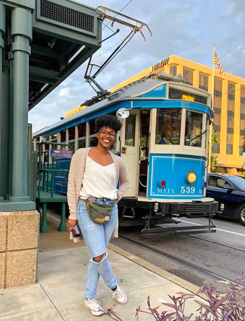 Women standing in front of trolly in downtown Memphis