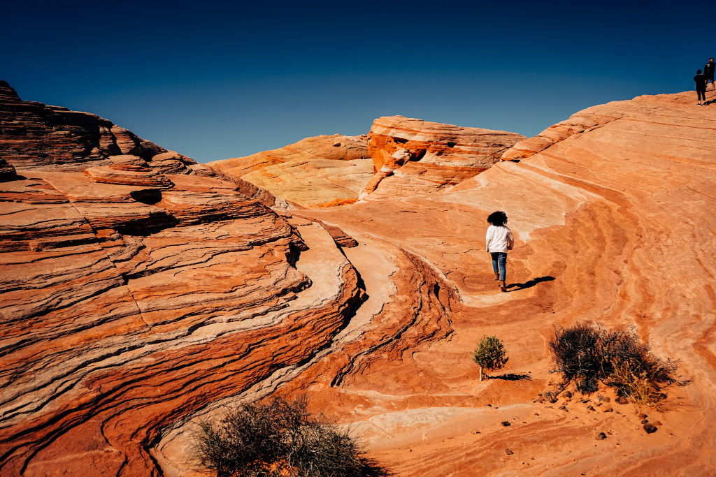 little girl walking on the wave trail at valley of fire state park on a nevada road trip