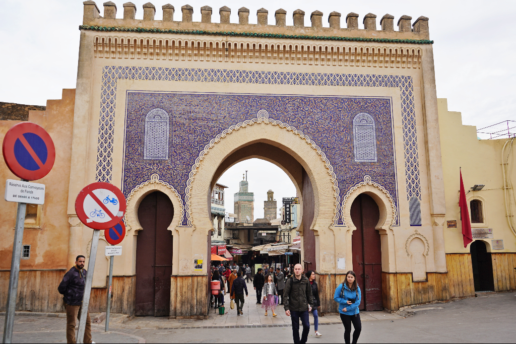 tourists walking through the blue side of Bab Boujloud which is one of the most popular things to do in fes