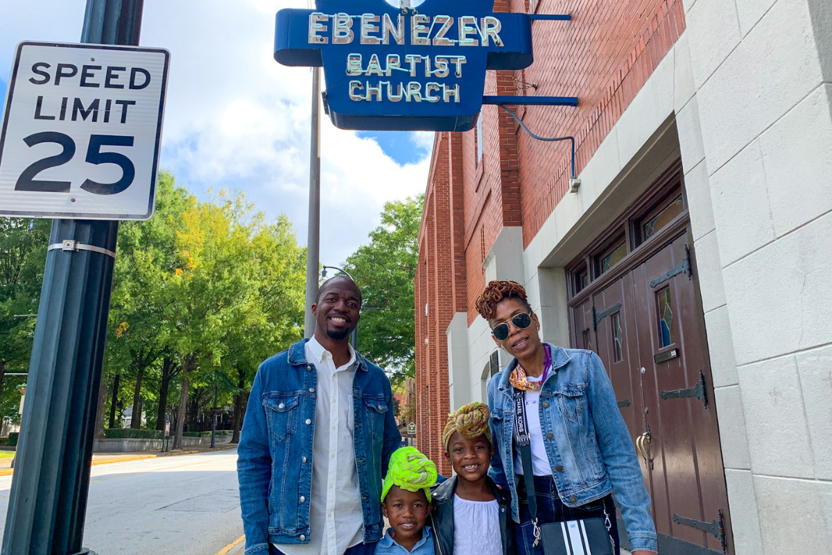 3 generations, grandma, dad and two kids standing in front of the Ebenezer Baptist Church in Atlanta